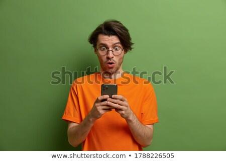 Meglepődött izgatott szótlan jóképű fickó narancs Stock fotó © benzoix