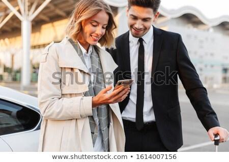 Imagem homem em pé bagagem celular jovem Foto stock © deandrobot