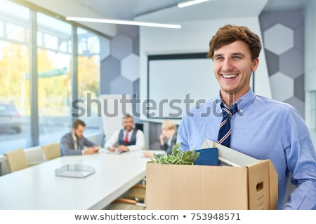 happy employee with personal stuff at office Stock photo © dolgachov