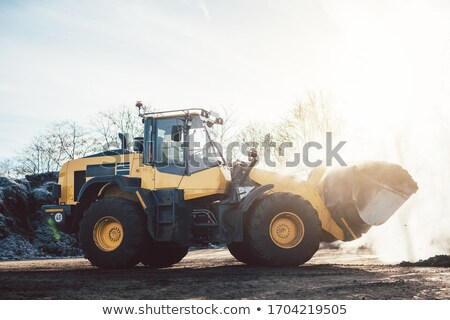 Wheel loader working on heap with biomass for composting Stock photo © Kzenon