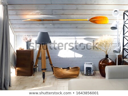 Light living room with lamps and paddle on wall Stock photo © dashapetrenko