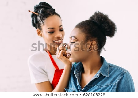 Pretty african american make up artist woman Stock photo © darrinhenry