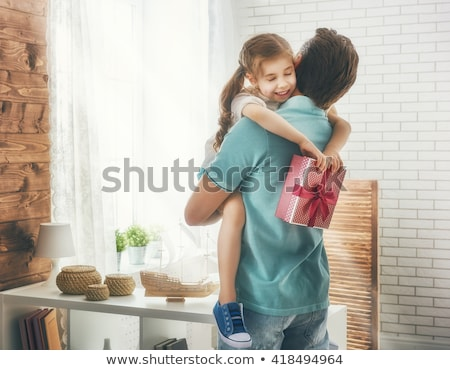 portrait of loving father holding his family stock photo © get4net