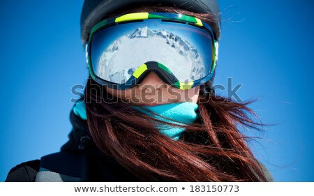 Cold young woman in a ski hat and goggles Stock photo © photography33