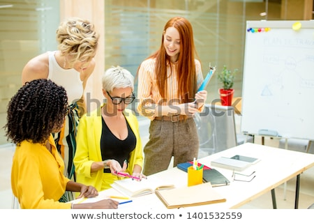 blond businesswoman with pen Stock photo © dolgachov