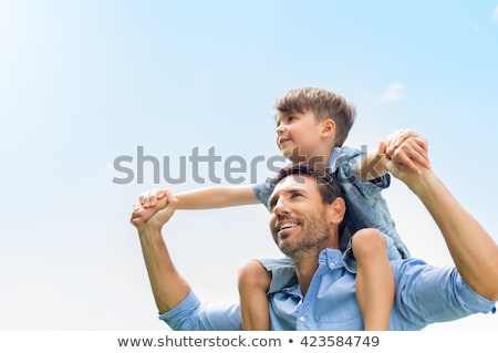little boy riding on his fathers shoulders stock photo © photography33