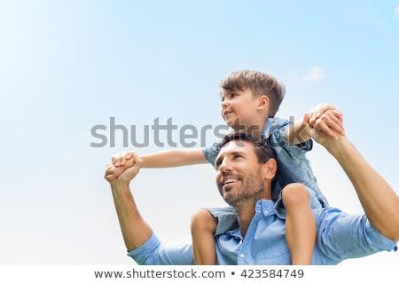 Kicsi fiú lovaglás vállak mosoly boldog Stock fotó © photography33