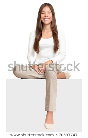 Stockfoto: Woman Sitting Showing Billboard Sign