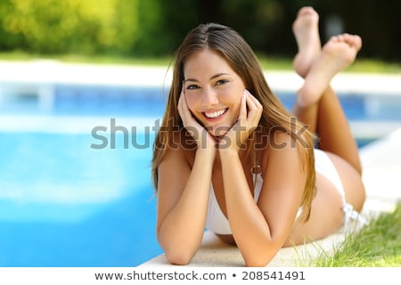 Attractive woman at a poolside Stock photo © photography33