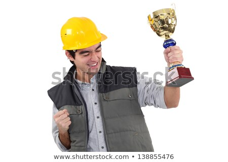 craftsman holding a golden cup Stock photo © photography33