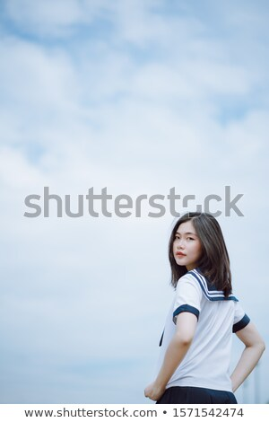 Smiling young lady, turned half back Stock photo © stockyimages