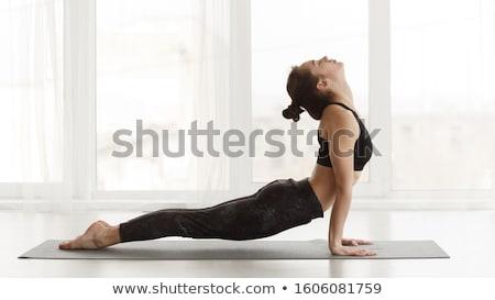 гибкий йога женщину ног изолированный Сток-фото © stockyimages