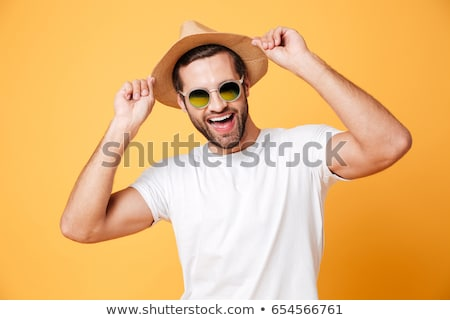 man in a hat with a camera stock photo © ruslanomega
