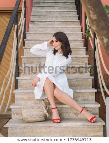 brunette in red Stock photo © carlodapino