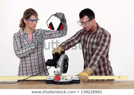 woman making sure man uses hearing protection stock photo © photography33