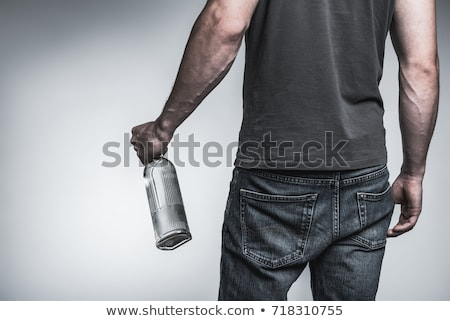 adult man holding an alcoholic drink Stock photo © juniart