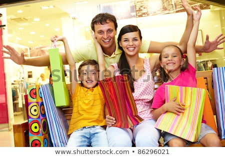 A man with plenty of shopping bags. Stock photo © photography33