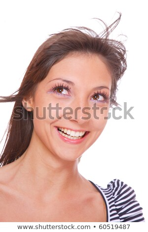 Stock photo: Closeup of young attractive caucasian girl smiling to the camera, holding mountain ash berries in he