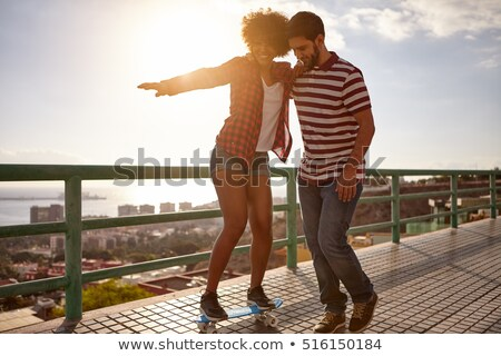 Stock photo: casual man looks down with sunset behind