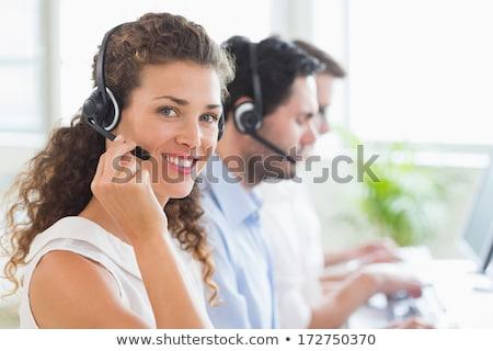 Zâmbitor femeie personal executiv prezinta Imagine de stoc © stockyimages