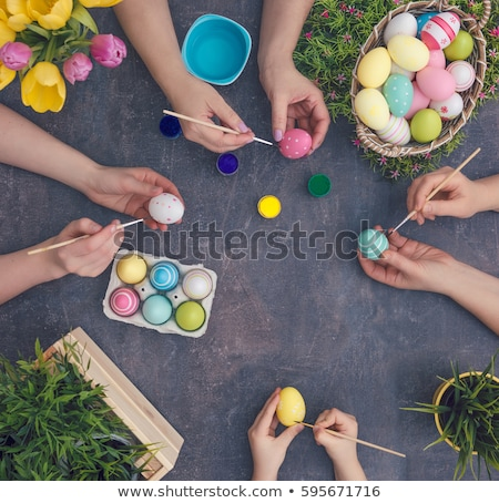 Basket of brightly coloured Easter Eggs Stock photo © juniart