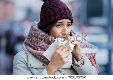 woman with a cold holding a tissue, outdoors Stock photo © Nobilior