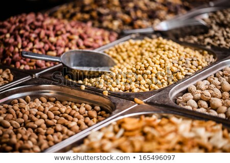 Market stand with fresh dried fruit and nuts Stock photo © Nejron