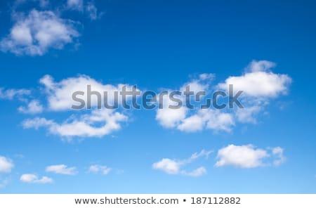 çok beyaz kabarık bulutlar parlak mavi Stok fotoğraf © morrbyte