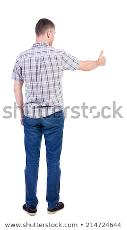 Handsome young man showing ok gesture. Isolated on white backgro stock photo © Nejron