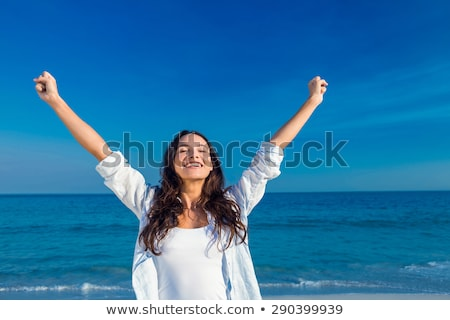 Young woman smiling with arm outstretched Stock photo © bmonteny