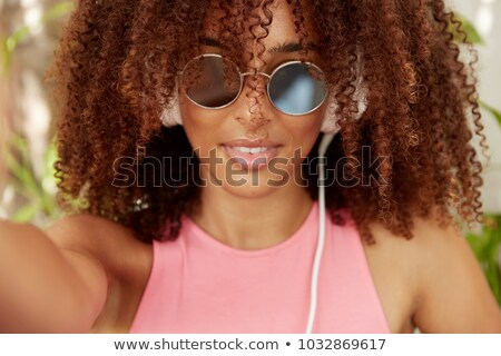 Young Woman Wearing Fashion Shades and Headphone Stock photo © stryjek