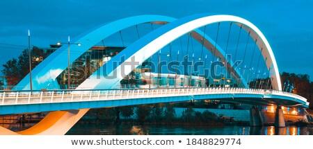 Tramway on the bridge at sunset Stock photo © vwalakte