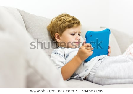 happy 2 years old boy using a digital tablet computer stock photo © vladacanon