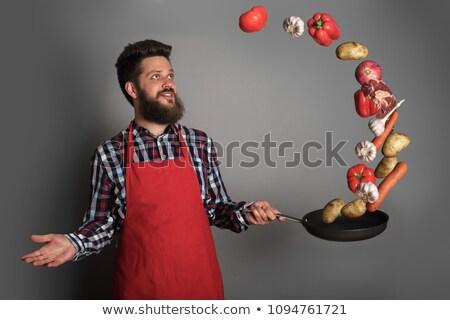 Chef jongleren maaltijden voedsel hand werk Stockfoto © HASLOO
