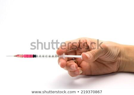 Mano tenere usa e getta siringa isolato bianco Foto d'archivio © digitalr