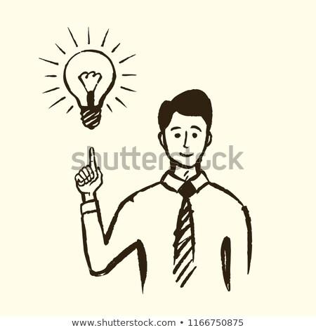 smiling man pointing finger up to lighting bulb Stock photo © dolgachov