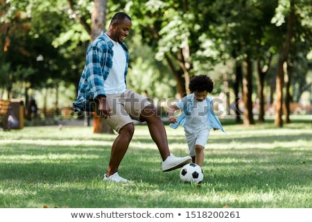 preschool child with soccer ball stock photo © klinker