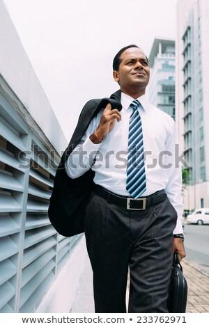 Businessman with jacket on shoulder  Stock photo © cherezoff