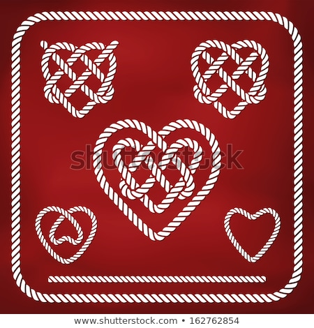 heart shaped red knot on jute rope stock photo © tetkoren