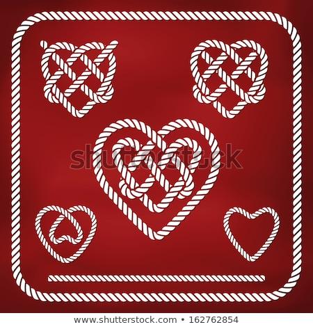 Heart shaped red knot on jute rope Stock photo © tetkoren