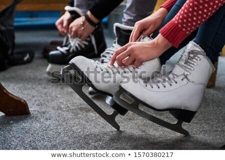 Woman tying skates Stock photo © fotoedu