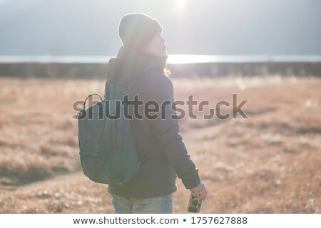 Hipster female photographer exploring autumn nature landscapes and taking pictures Stock photo © stevanovicigor