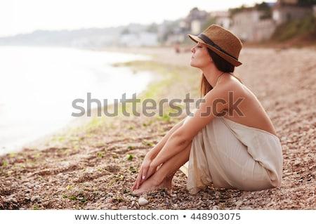 sitting beautiful young woman on seacoast Stock photo © Paha_L