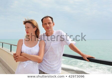 young man and beautiful woman on veranda near seacoast Stock photo © Paha_L