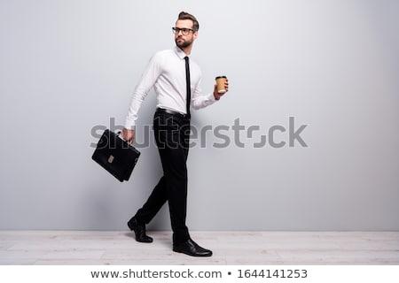 Fiatalember aktatáska izolált fehér háttér üzletember Stock fotó © Elnur
