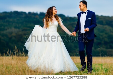 bride with the fiance they run on the lawn Stock photo © Paha_L