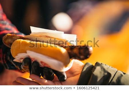 Woman eating grilled sausage on Christmas market Stock photo © Kzenon