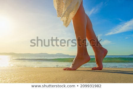 beach feet closeup   woman walking in water waves stock photo © maridav
