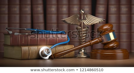 A law book with a gavel - Health law Stock photo © Zerbor