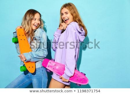 Alegre mujer posando skateboard aislado blanco Foto stock © deandrobot